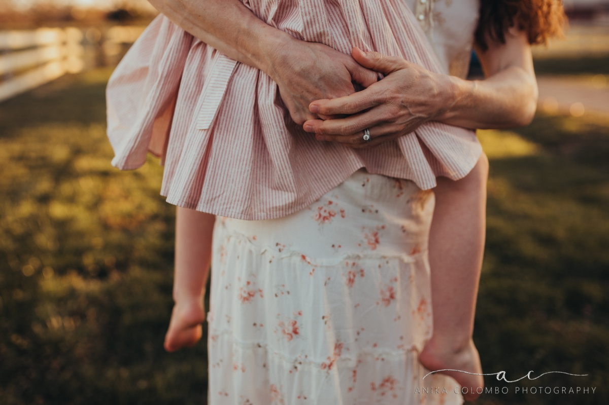 Mothers hands holding daughter