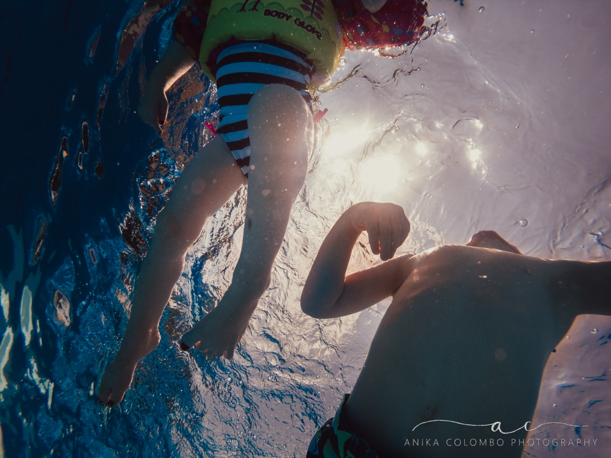 underwater image of kids swimming