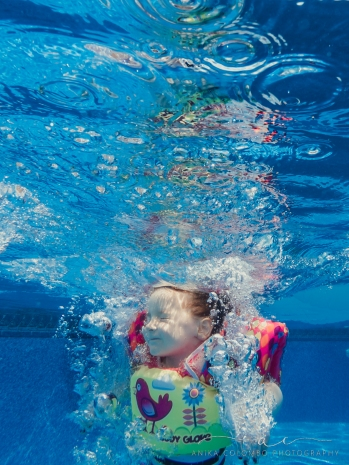 underwater image of kid jumping into a pool