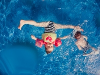 underwater photograph girl flipping into a pool