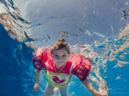 underwater image of girl swimming in a pool