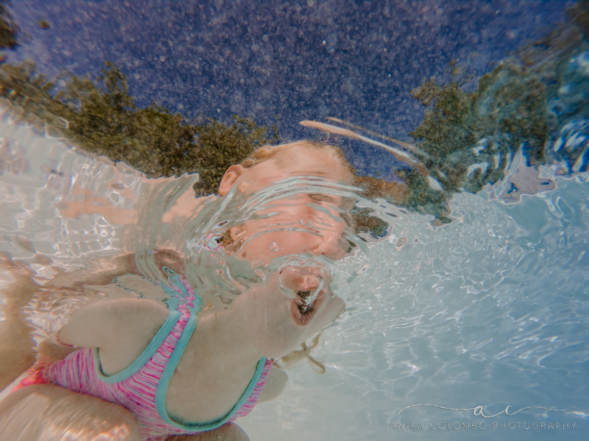underwater photography little girl blowing bubbles in a pool