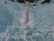 underwater photography of child swimming