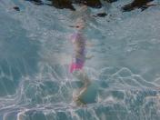 underwater photography of child swimming