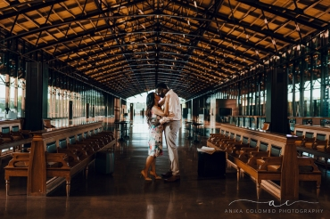 man and woman embracing in front of empty benches at mainstreet station in richmond va