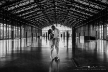 black and white photo of a couple embracing in the center of mainstreet station in richmond va