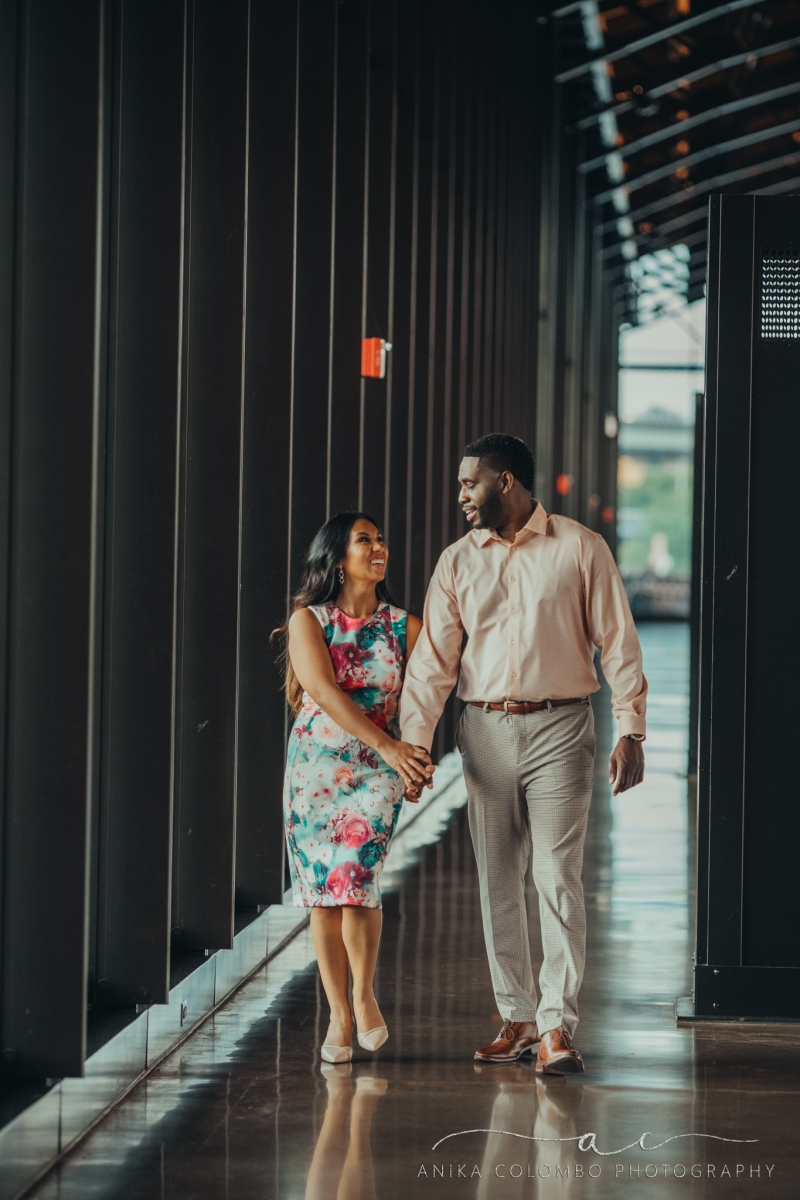 couple strolling hand in hand through mainstreet station in richmond va