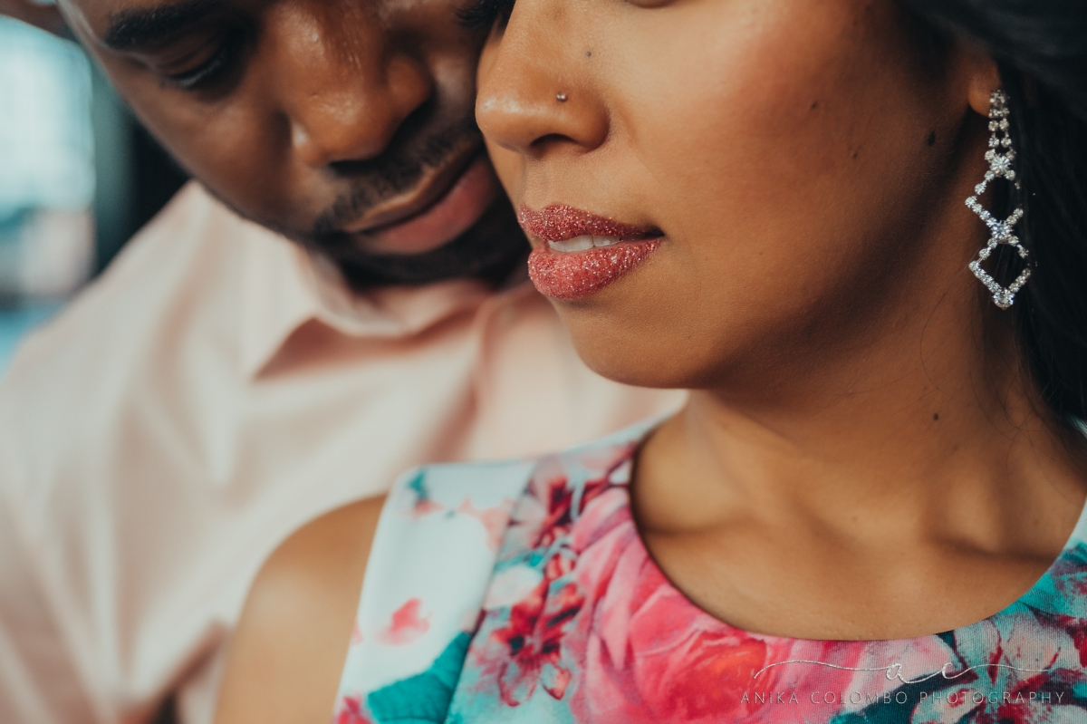 woman wearing glitter lipstick with a man embracing her from the back